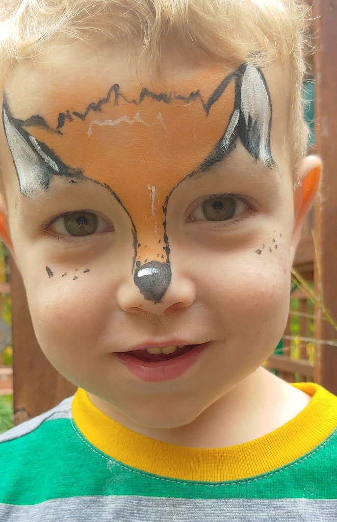Boy with fox face paint